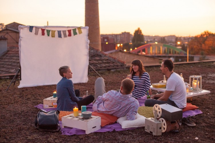 Relaxed rooftop picnic at sunset