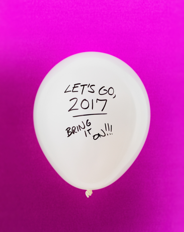 Short series of balloons with humorous sayings written on them.