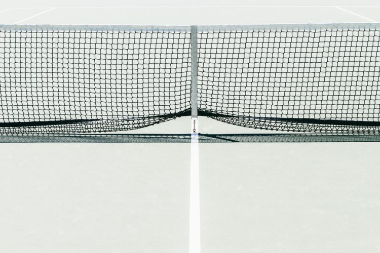 Tennis net in a tennis court