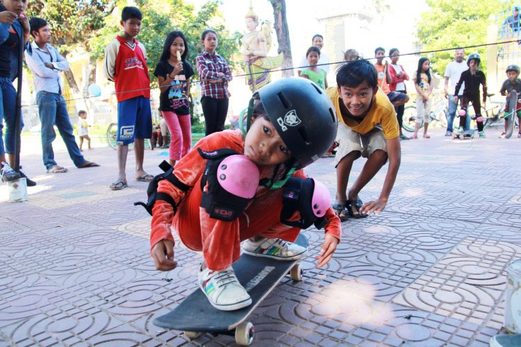 9. outreach - Skateistan_Press Image_ Outreach first time skating_ Phnom Penh_©Skateistan
