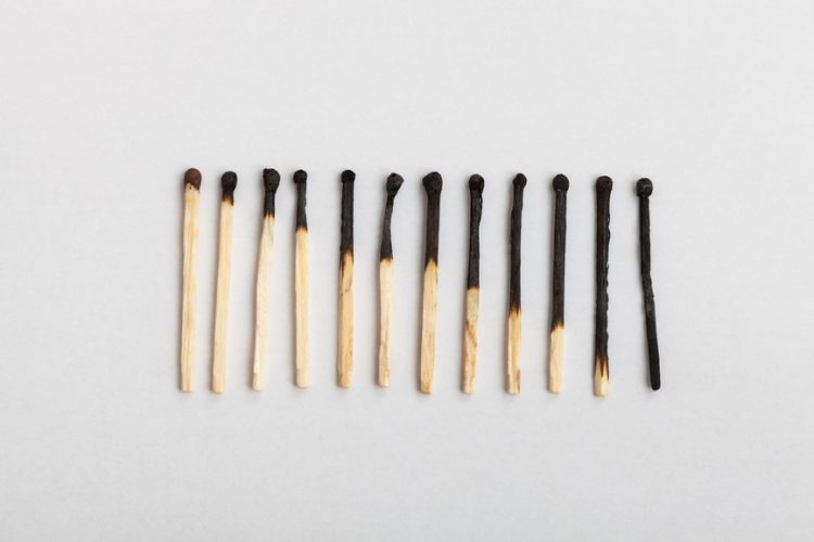 A row of matches in which they become more burnt from left to right