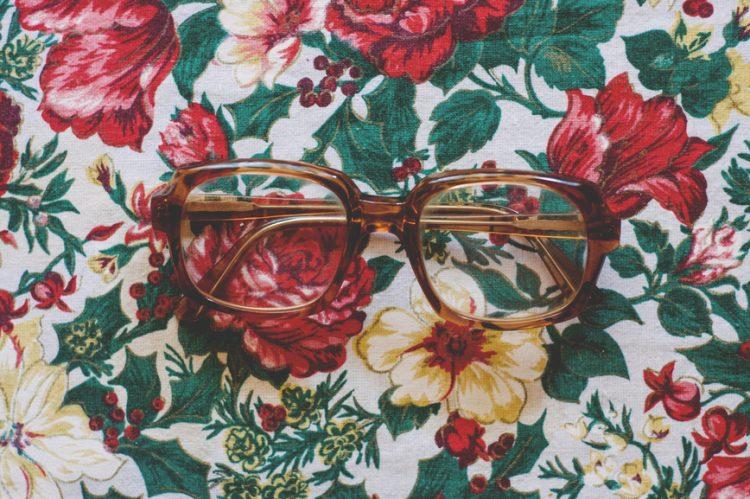Eye glasses on a floral tablecloth