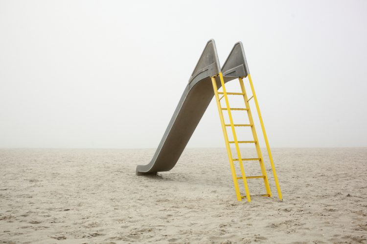 Yellow ladder on a deserted beach
