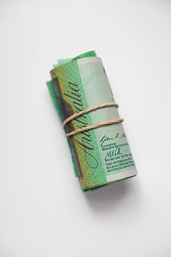 Rolled $100 Australian bill