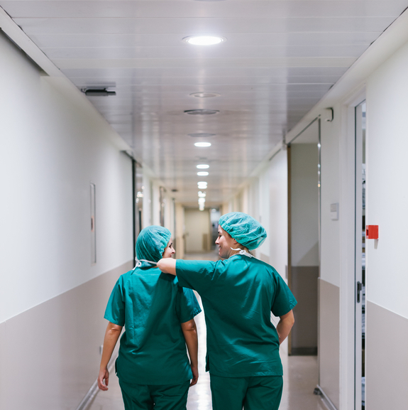 Surgeons Walking Through a Hospital Corridor