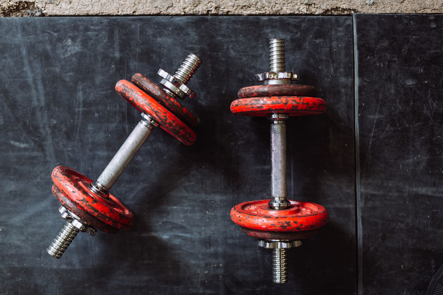 A pair of red dumbells