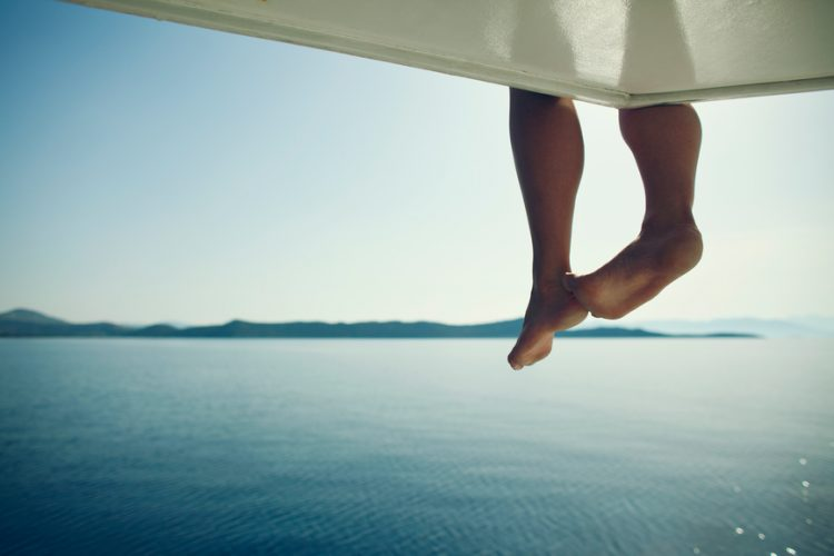 Woman's feet dangling off a perch