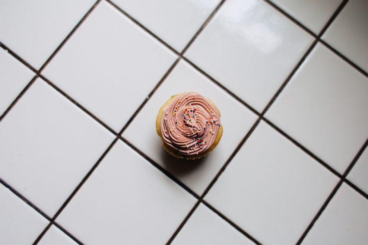 A chocolate cupcake on tiles