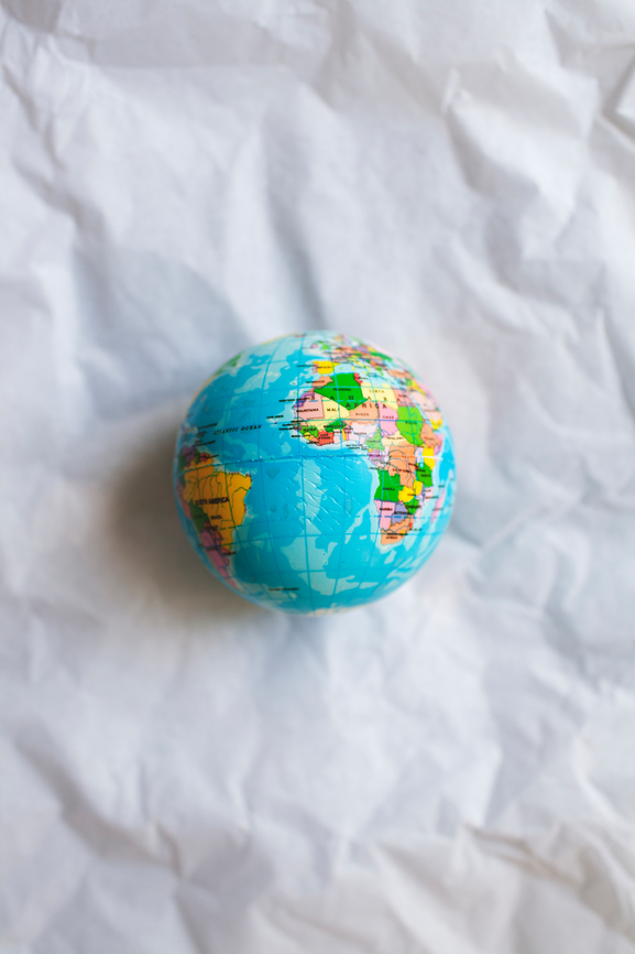Blow-up globe on a piece of crinkled white paper