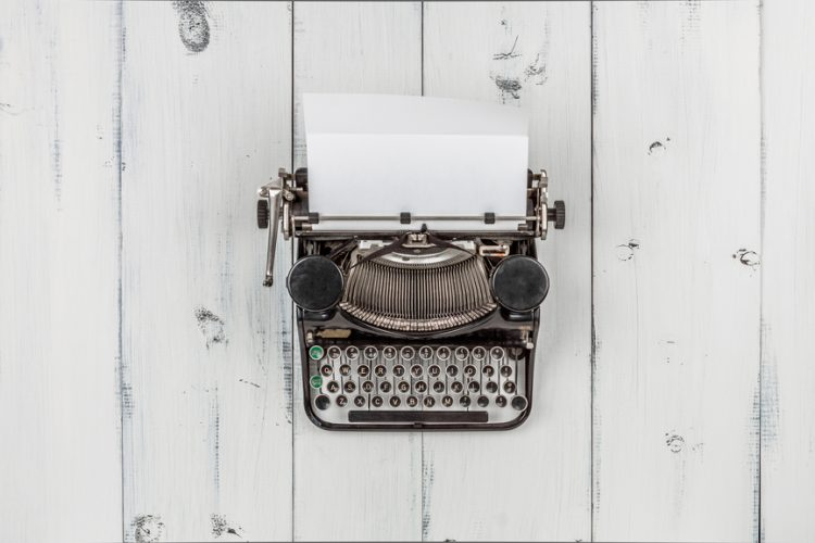 Typewriter with a blank sheet of paper protruding