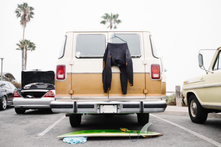 Wetsuit hanging on a van.