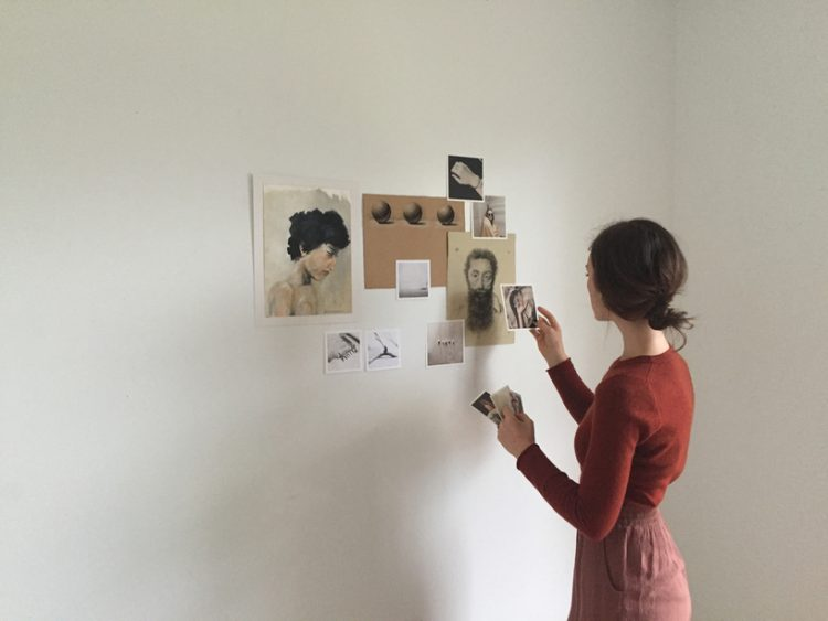 Woman making a wall collage