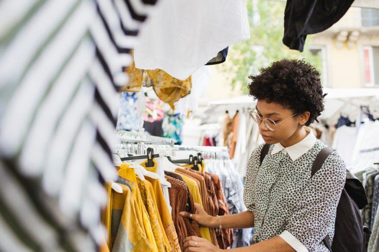 Woman at clothing market stall