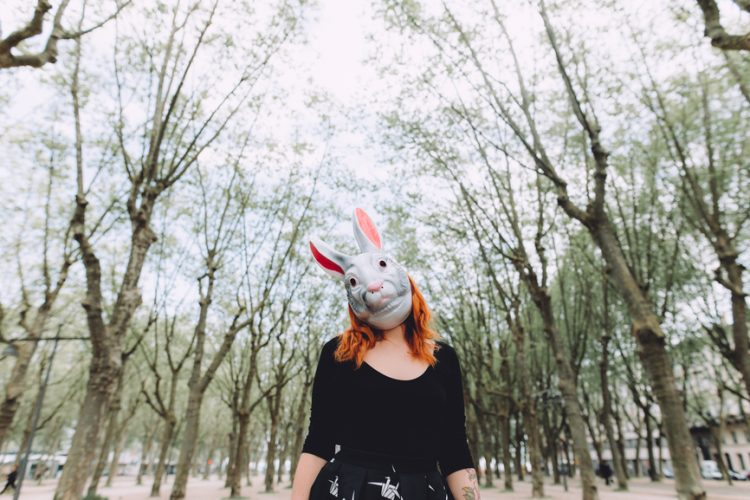 Woman outdoors wearing a bunny mask