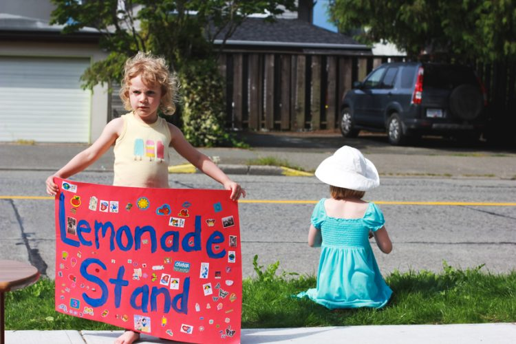 Two little girls and their lemonade stand
