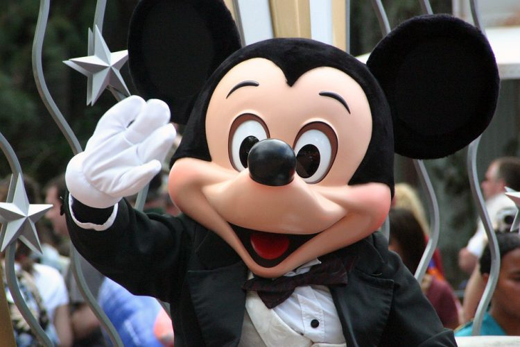 Mickey Mouse waving during a parade