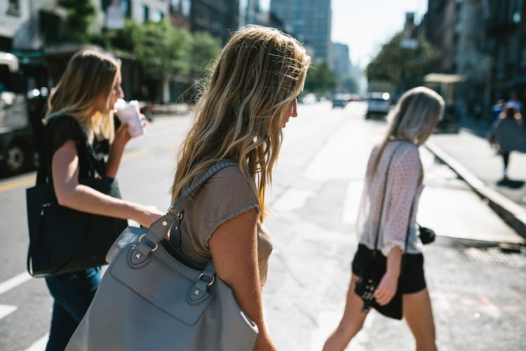 Young women walking in the city.